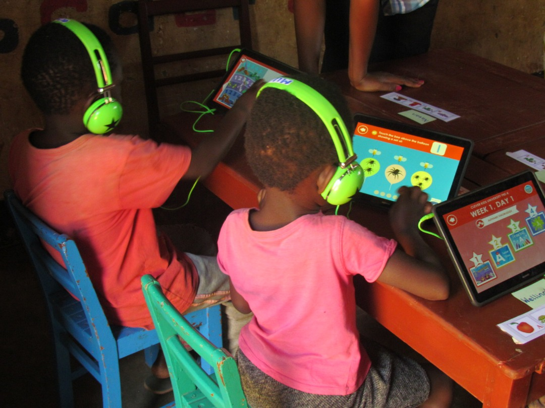 Children are given headphones so that they can focus on their own work
