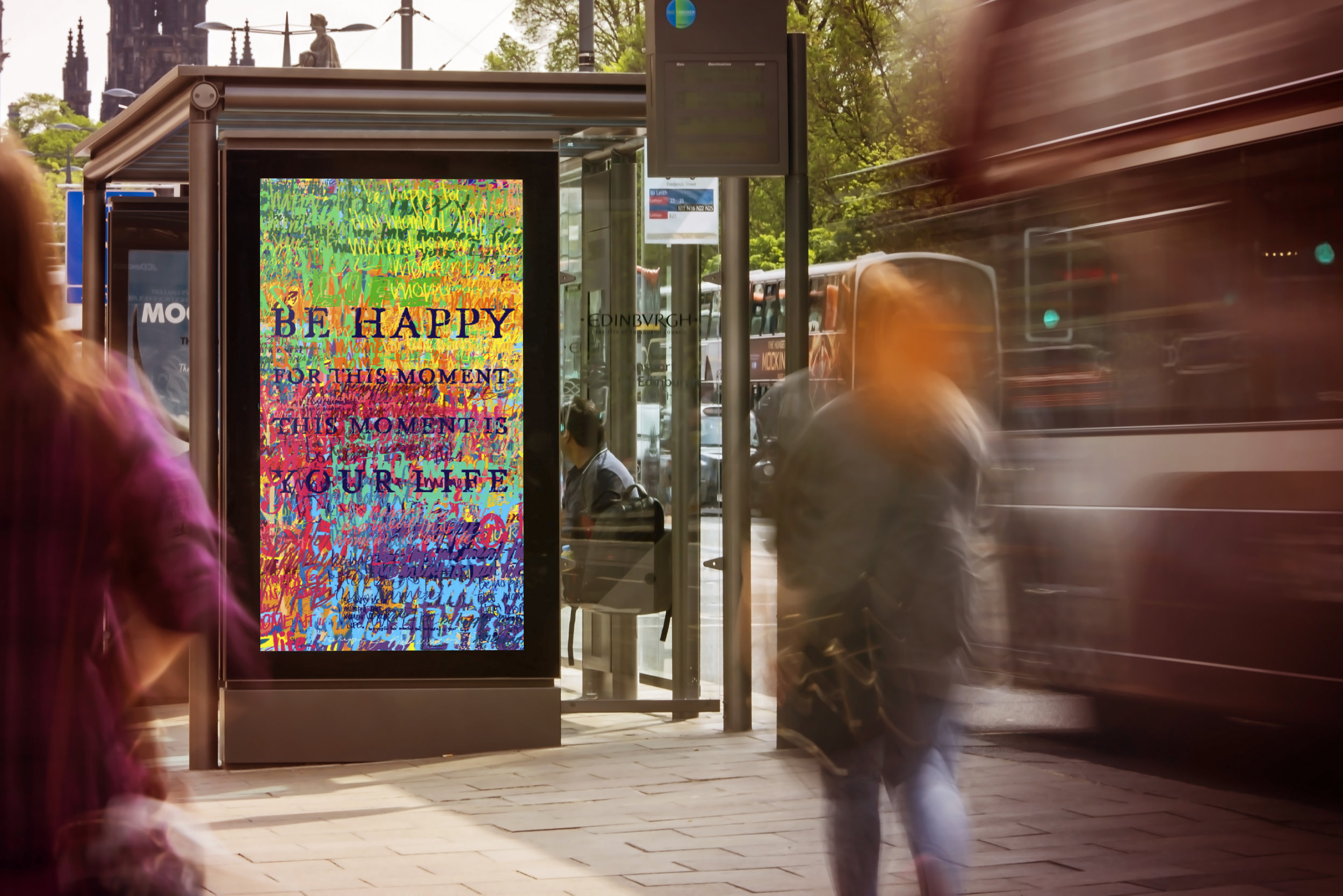 """Public art applied to bus stop advertising with the quote """"Be happy for this moment, this moment is your life."""""""