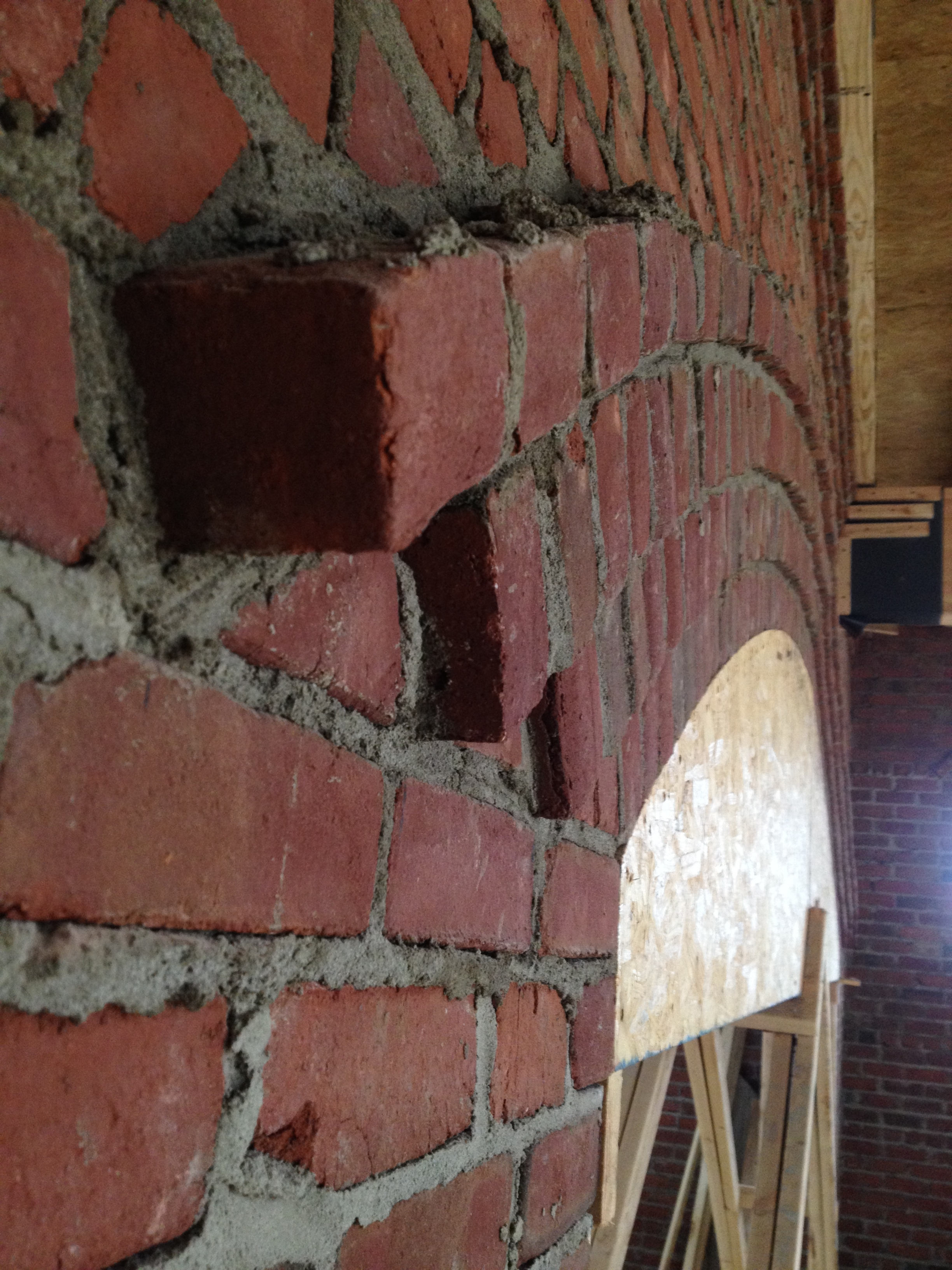 structural masonry, corbeled coursework of buttressing arch