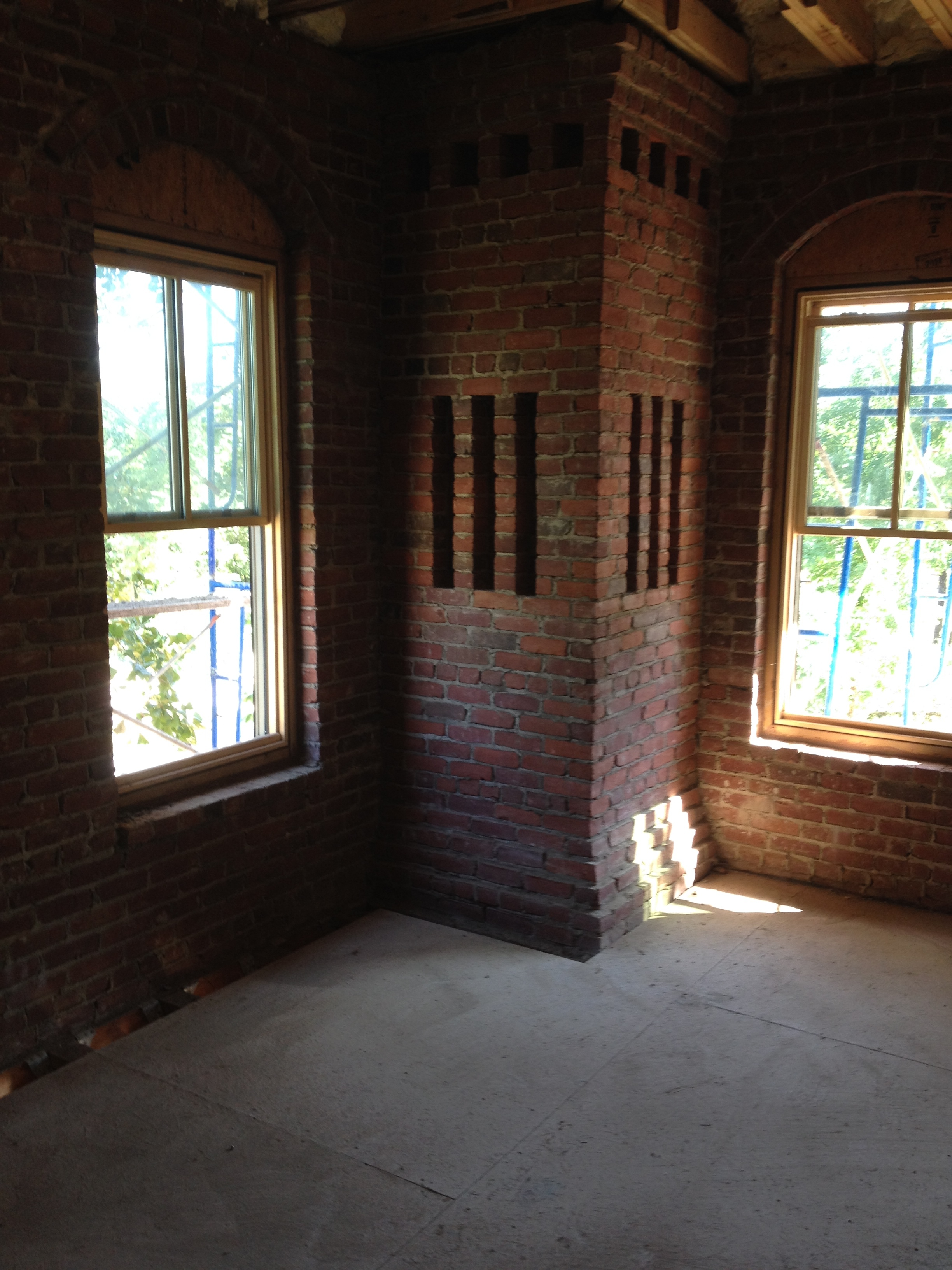 structural masonry, fireplace chimney, decorative corbeling and flutes