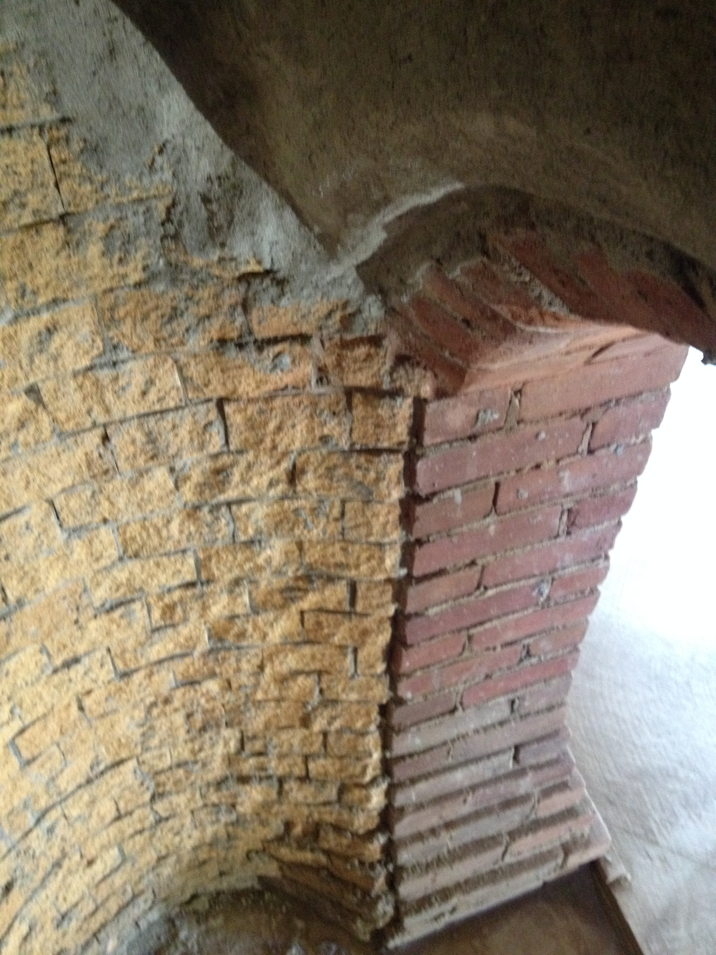 structural masonry fireplace, firebrick meets clay brick in the firebox.