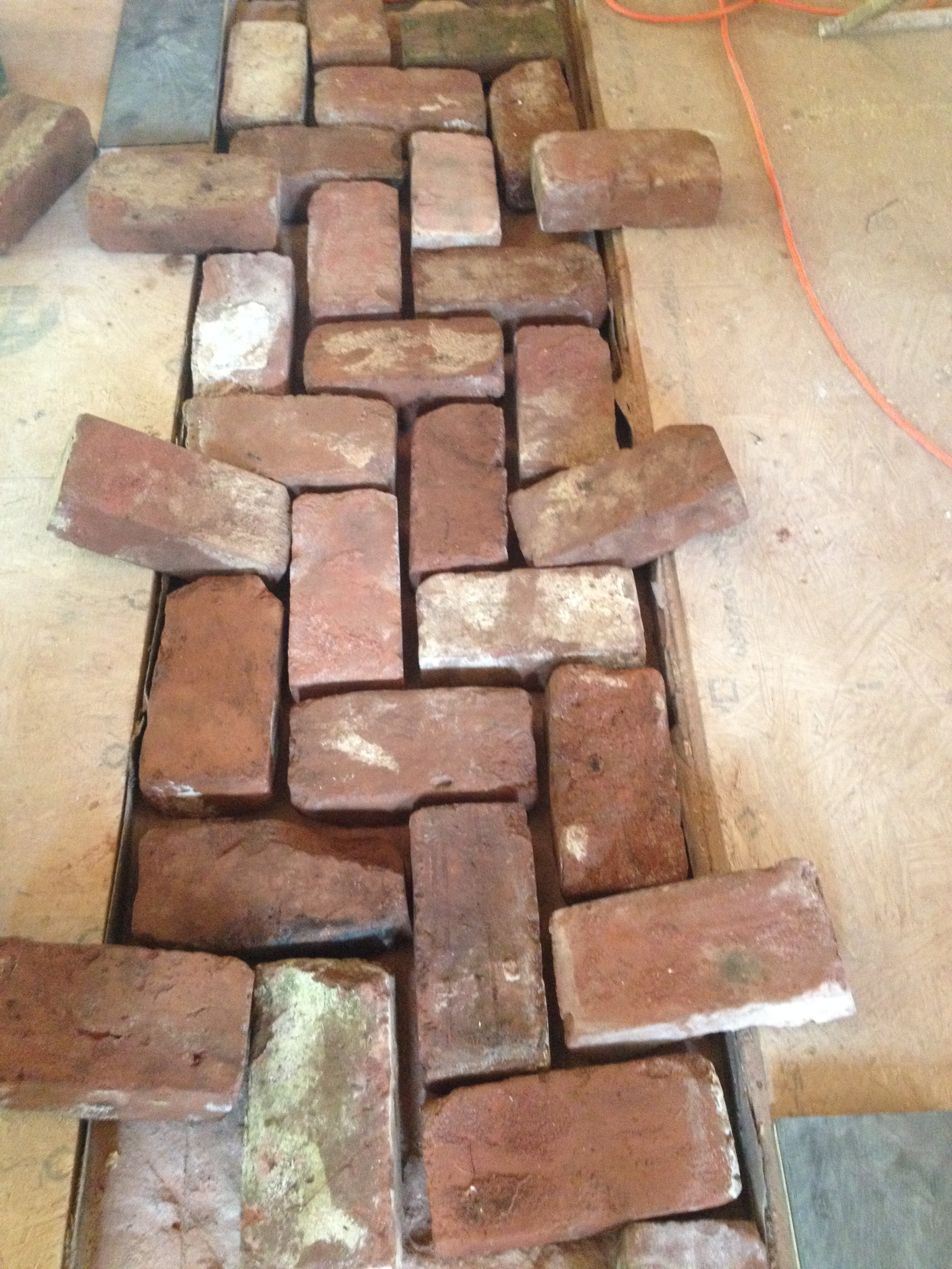 structural masonry, test fitting herringbone pattern for finished floor detail