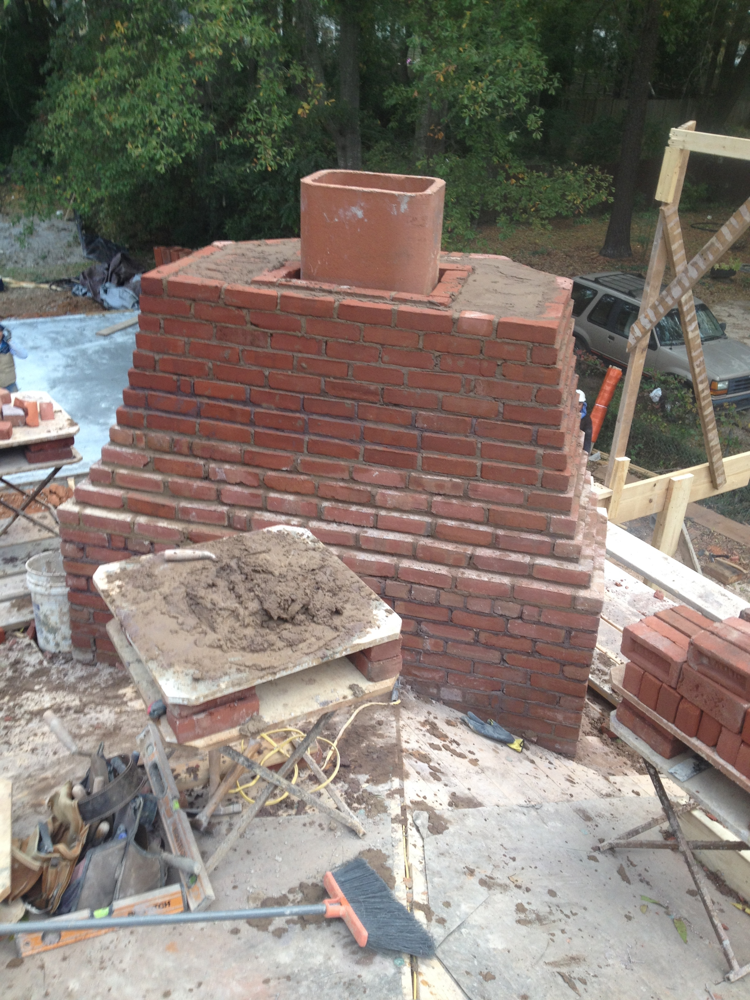 structural masonry, solid brick chimney of outside fireplace