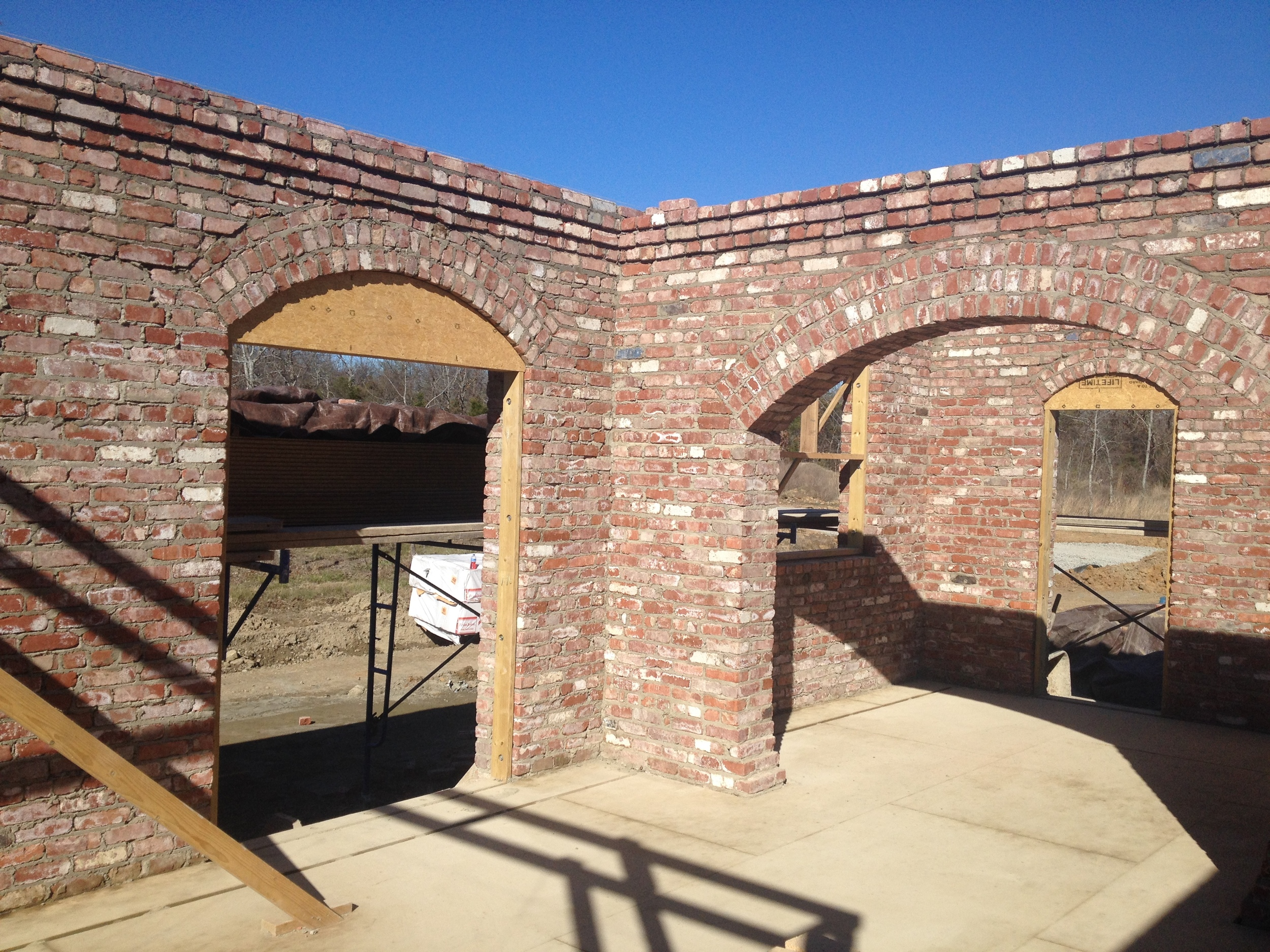 structural masonry, triple wythe walls built out of salvage brick.