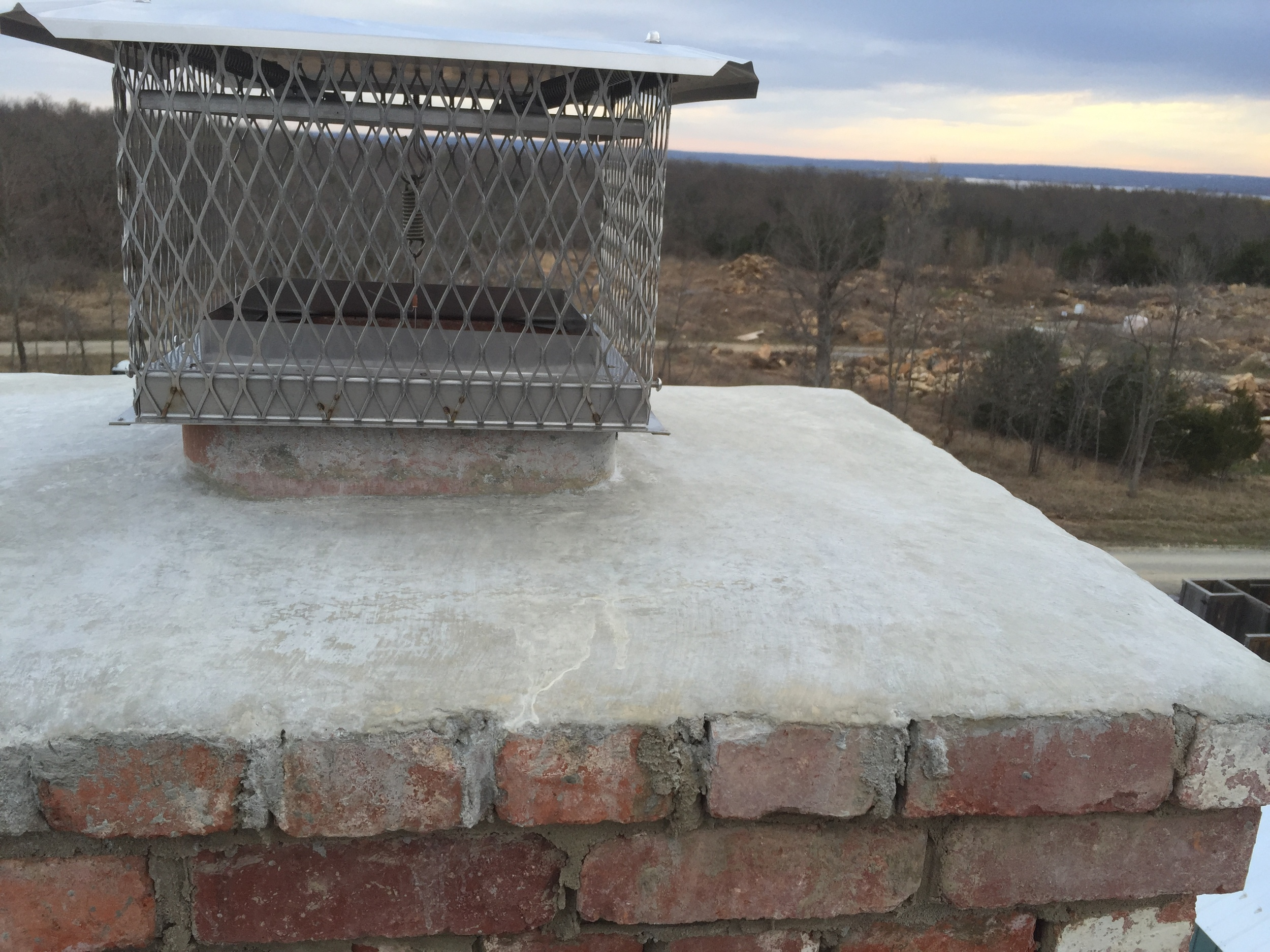 structural masonry, capped chimney fitted with metal damper