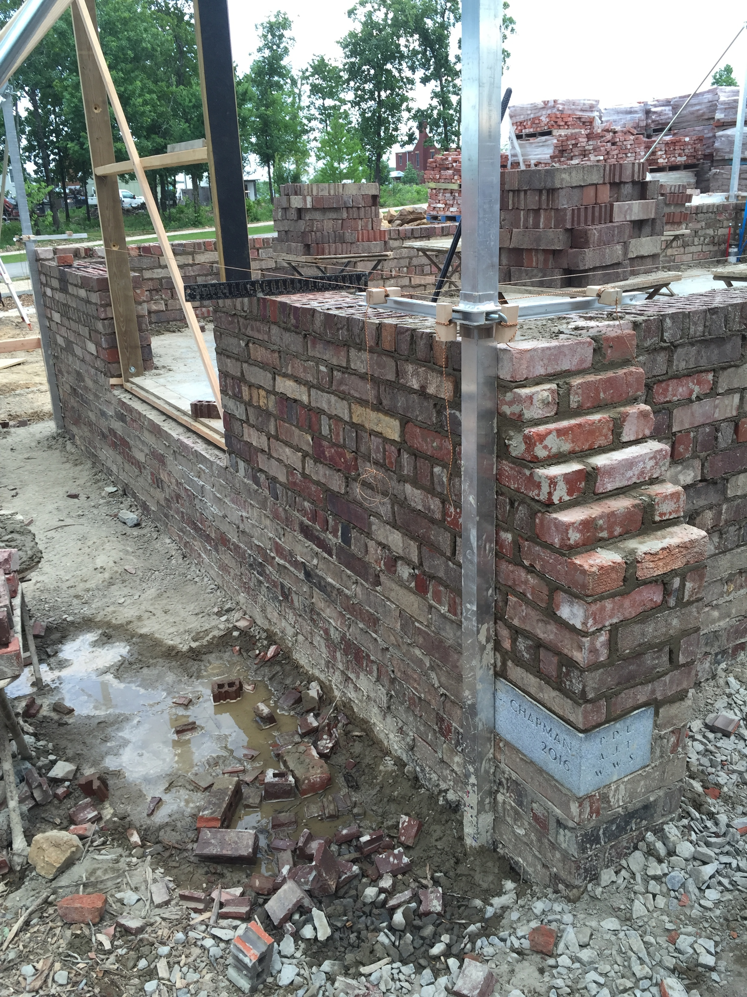 structural masonry, coursework on small brick cottage, corner buttressing detail, including a cornerstone