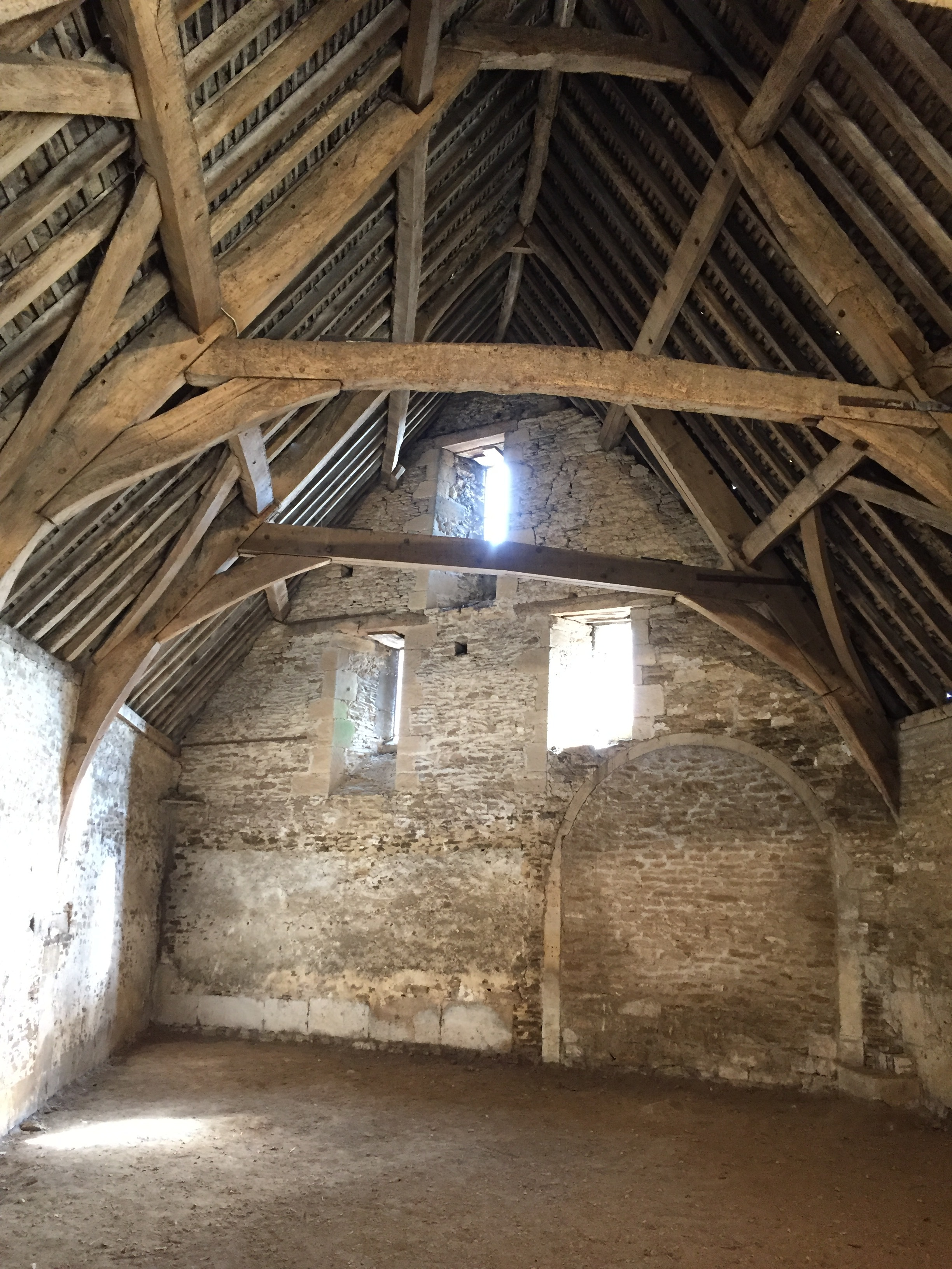 An interior glimpse of a tithe barn in Wiltshire, England.