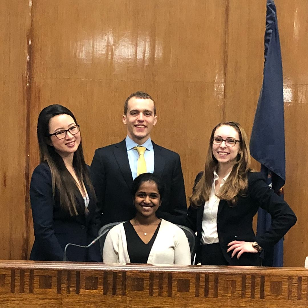 Tom Twitchell (Class of 2016) - On February 9-11, 2018, RUMTA '16 alumnus Thomas Twitchell competed on a three-attorney team representing the NYU School of Law at the TYLA New York Regional competition. The team was the only one to make it through the competition with a perfect record, earning one of two bids to the National Trial Competition. Tom represented the plaintiff, the wife of a man electrocuted while sampling grain from a railroad car. He also won an individual award as the tournament's top opener.RUMTA '16 alum Madhuri Swarna helped coach the team in preparation for the regional competition. The team will meet 27 other teams from across the country on April 4-8, 2018 in Austin, TX at the National Trial Competition. The Competition is hosted by the Texas Young Lawyers Association and sponsored by the American College of Trial Lawyers.