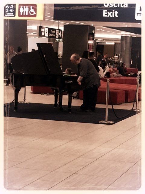 Photo courtesy of moi; capturing the moment the man began to play.