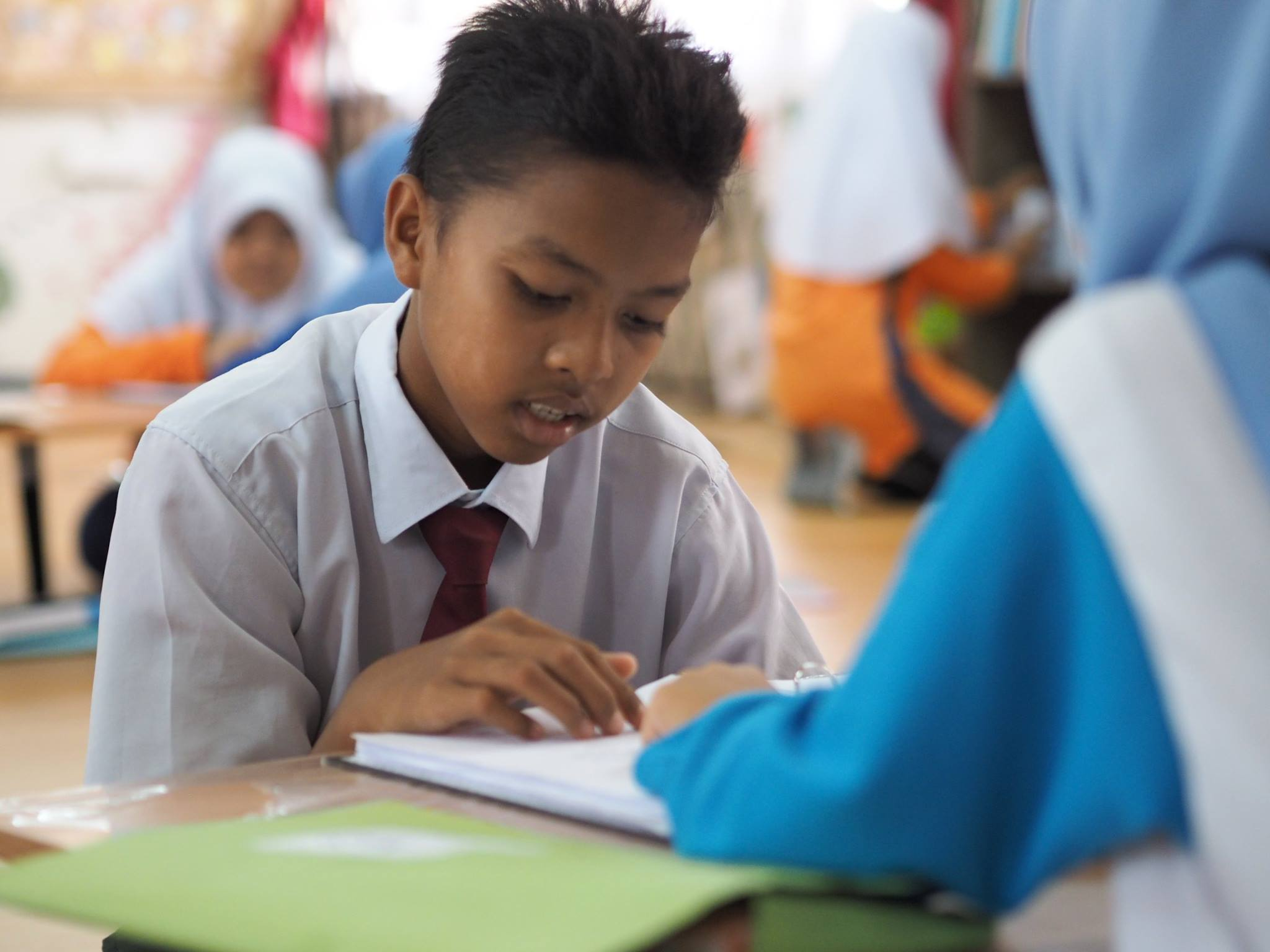 """""""The mentors confidence in using English improved. Though they are young, they were able to show patience and empathy when coaching their friends.""""  - Pn. Zuliani, SMK Bandar Baru Sentul"""