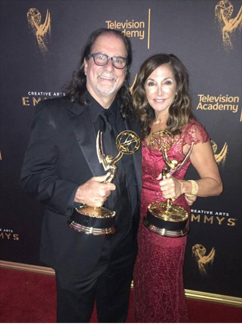 Glenn Weiss earns his 12th and 13th Emmy Awards at this year's ceremony - Glenn poses with Janis Svendsen, both holding the awards that he earned for producing the Tony Awards and directing the Academy Awards.