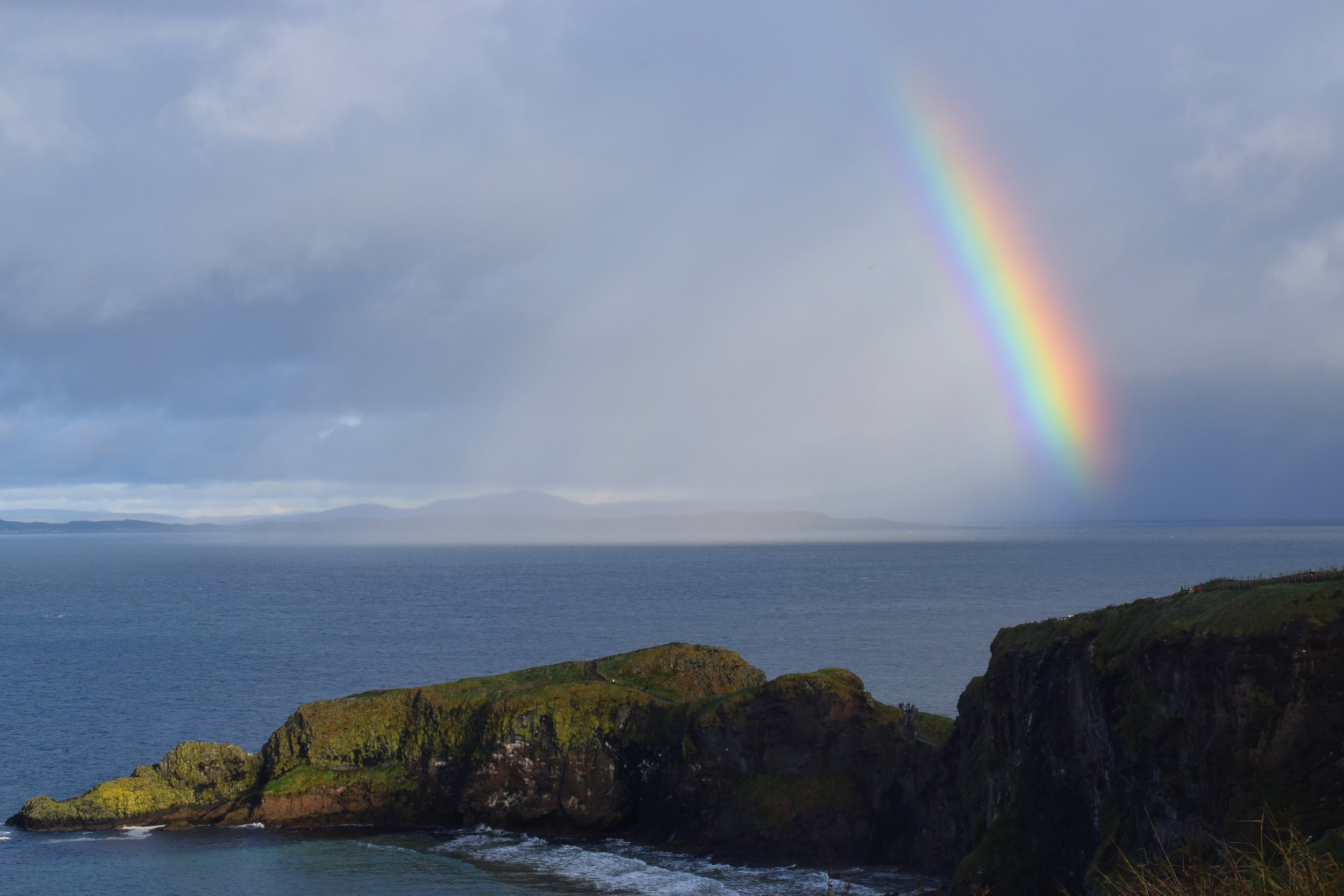 Rainbow over Rathlin Island,  the northernmost point of Ireland.   (Nikon D3330, 50mm, f/16, 1/  60 sec, ISO 200  )