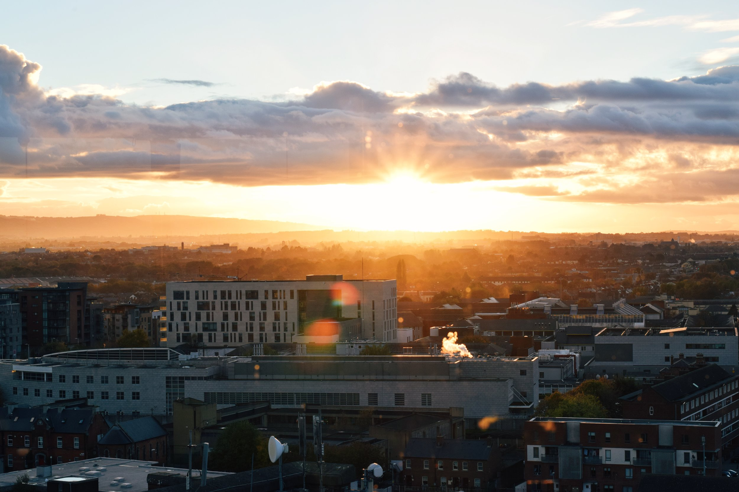 Dublin Sunset as seen from the seventh floor of The Guinness Storehouse Gravity Bar  (Nikon D3330, 50mm, f/10, 1/200 sec, ISO 400 image processed with VSCO E2 preset)