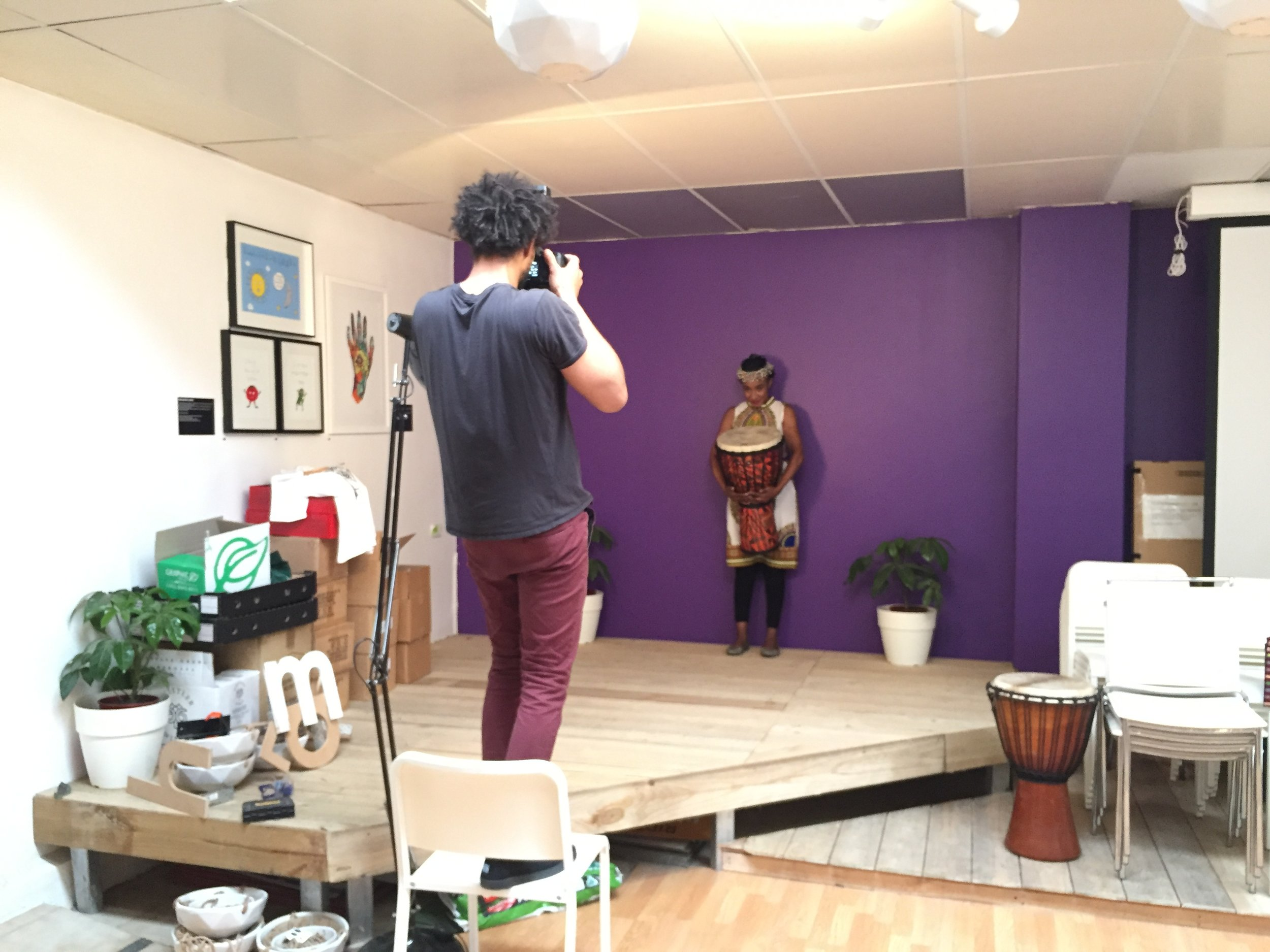 Dans taking pictures of Sheela in preparation for her drumming class