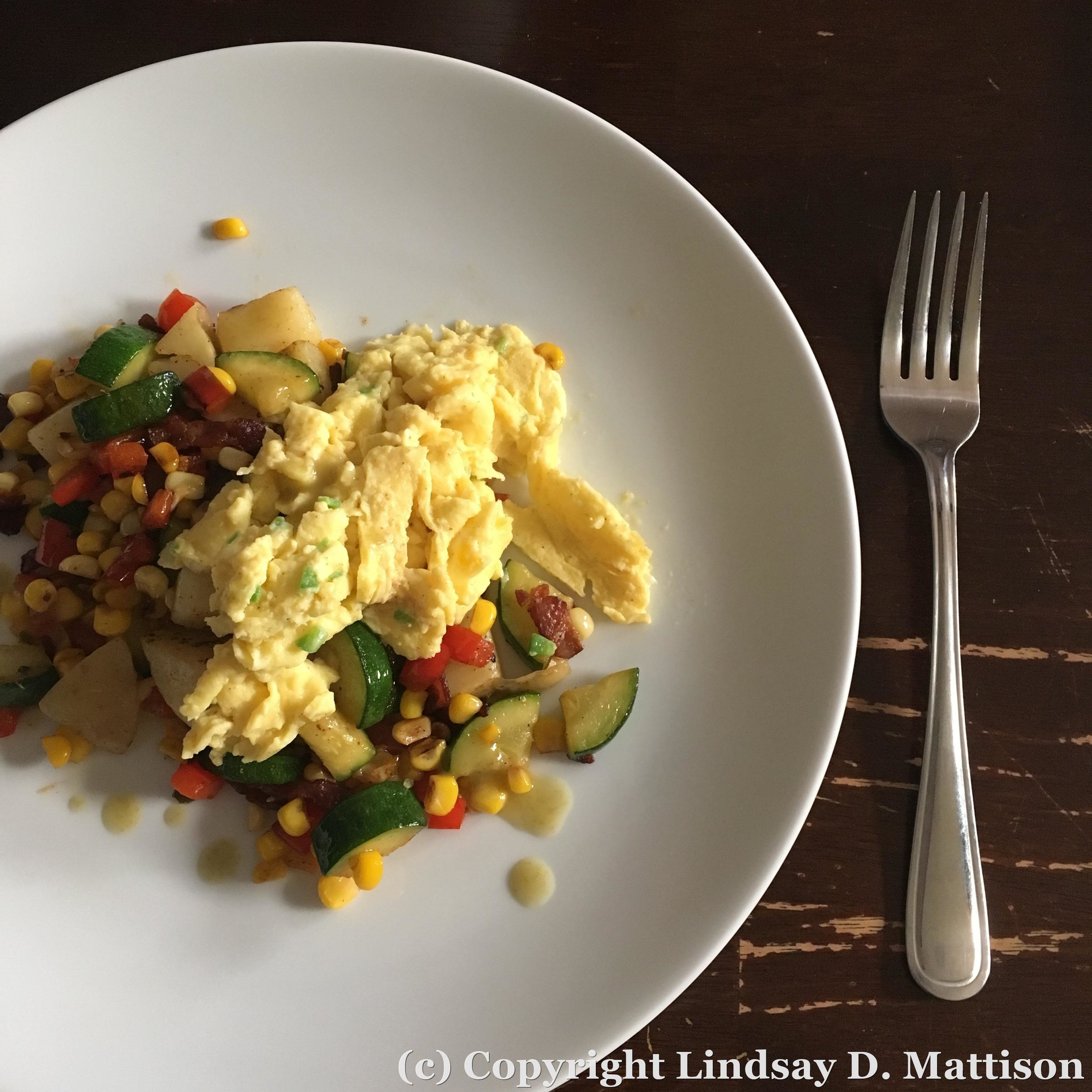 Summer on a plate: zucchini, red peppers, and corn topped with some softly scrambled eggs. I think I spy a piece of bacon on this plate...should I self describe as a bacontarian? Is that a real thing?