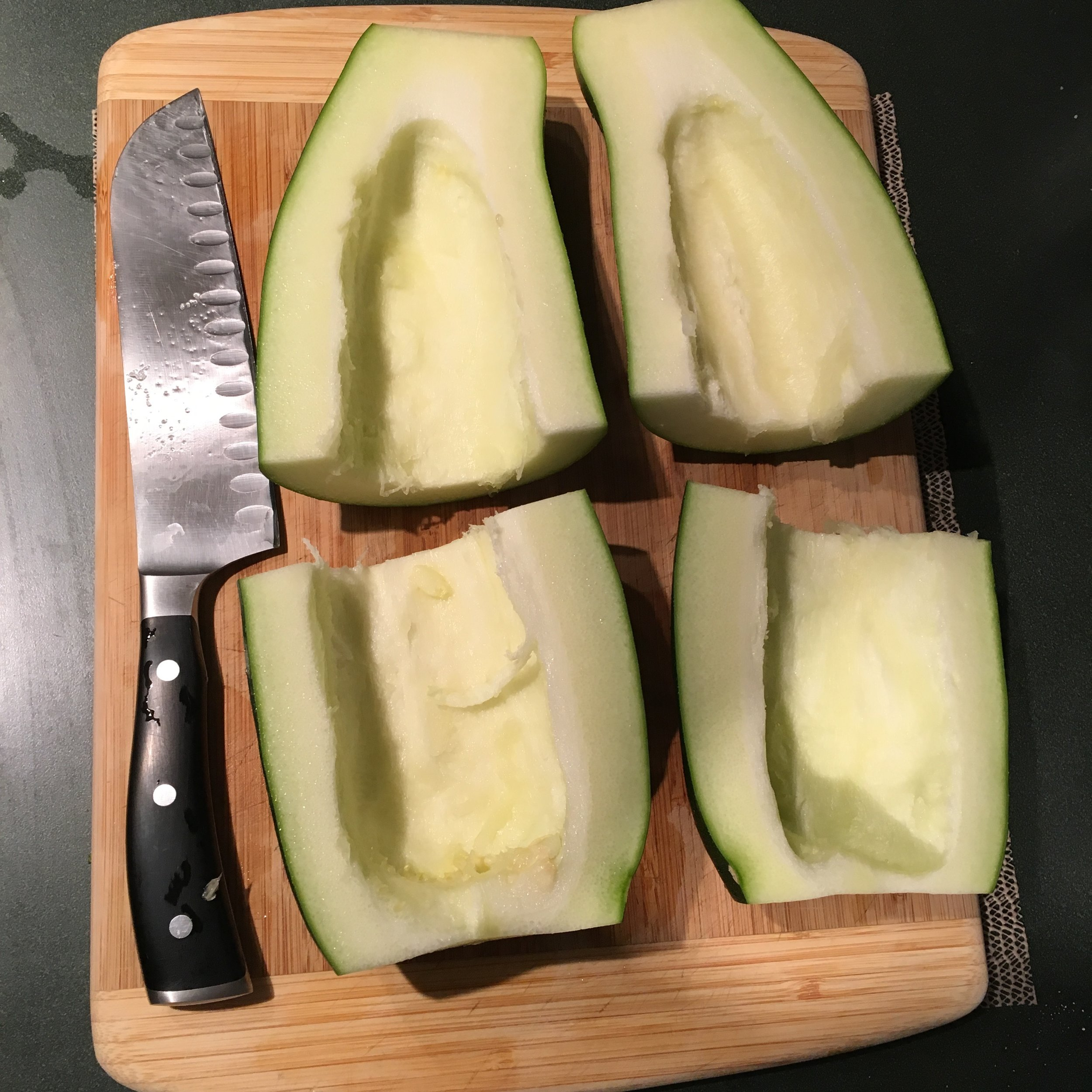 """In smaller zucchini, the seeds generally don't need to be removed, but that's a 7"""" blad santoku knife pictured, so I definitely removed the seeds on this guy!"""