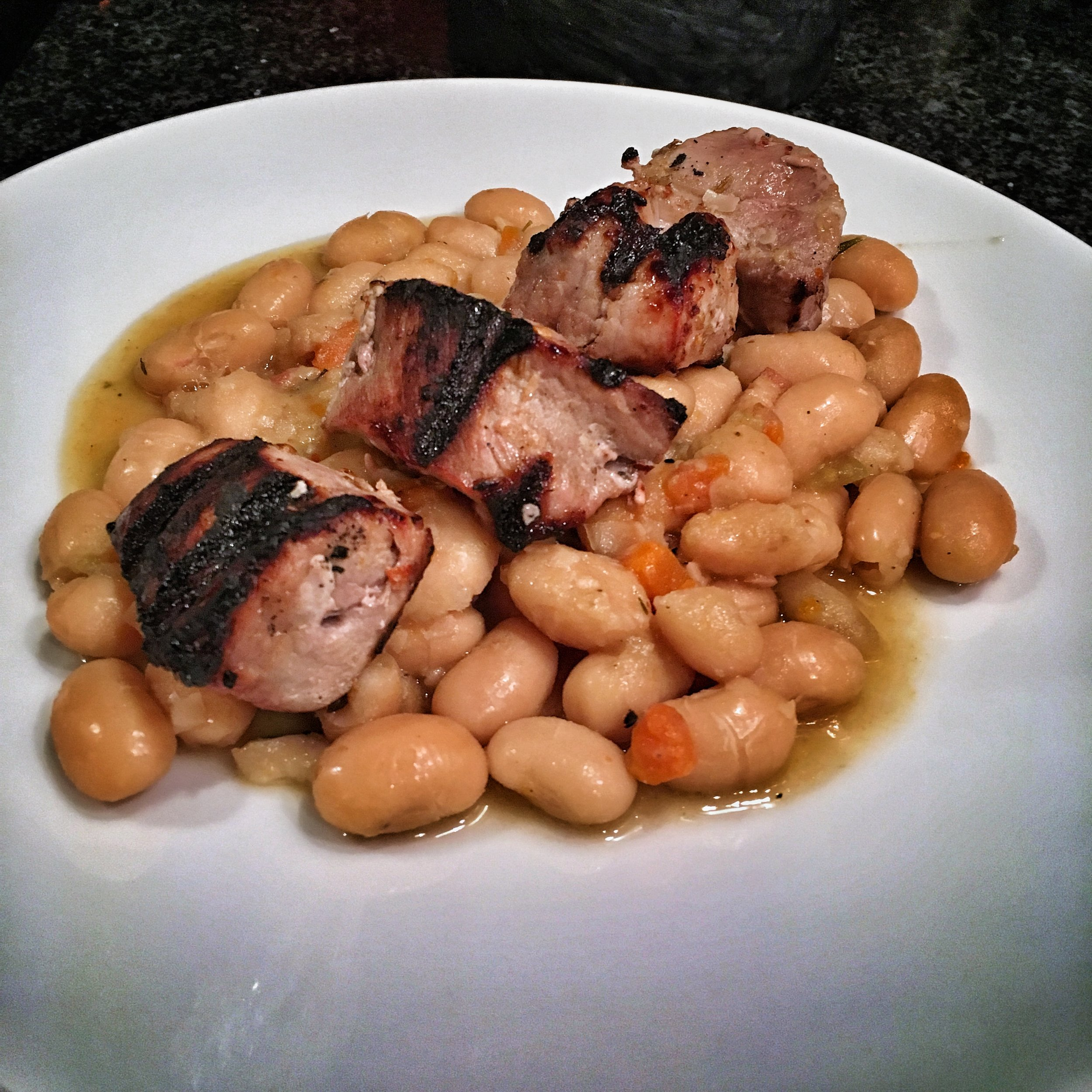 Pork tenderloin, marinated in gin and juniper, served over slowly simmered Mortgage Lifter beans.