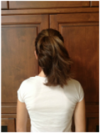 2.Brush hair back into a slick pony-tail, tying with a hair elastic.