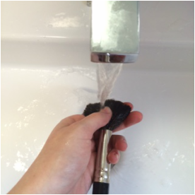 3. After, run the brush under the warm water. Focus the water on the bristles of the brush. Avoid the part where the bristles meet the metal on the handle. Getting water on the metal part of the handle can loosen/weaken the glue inside of the brush, resulting in a broken brush.