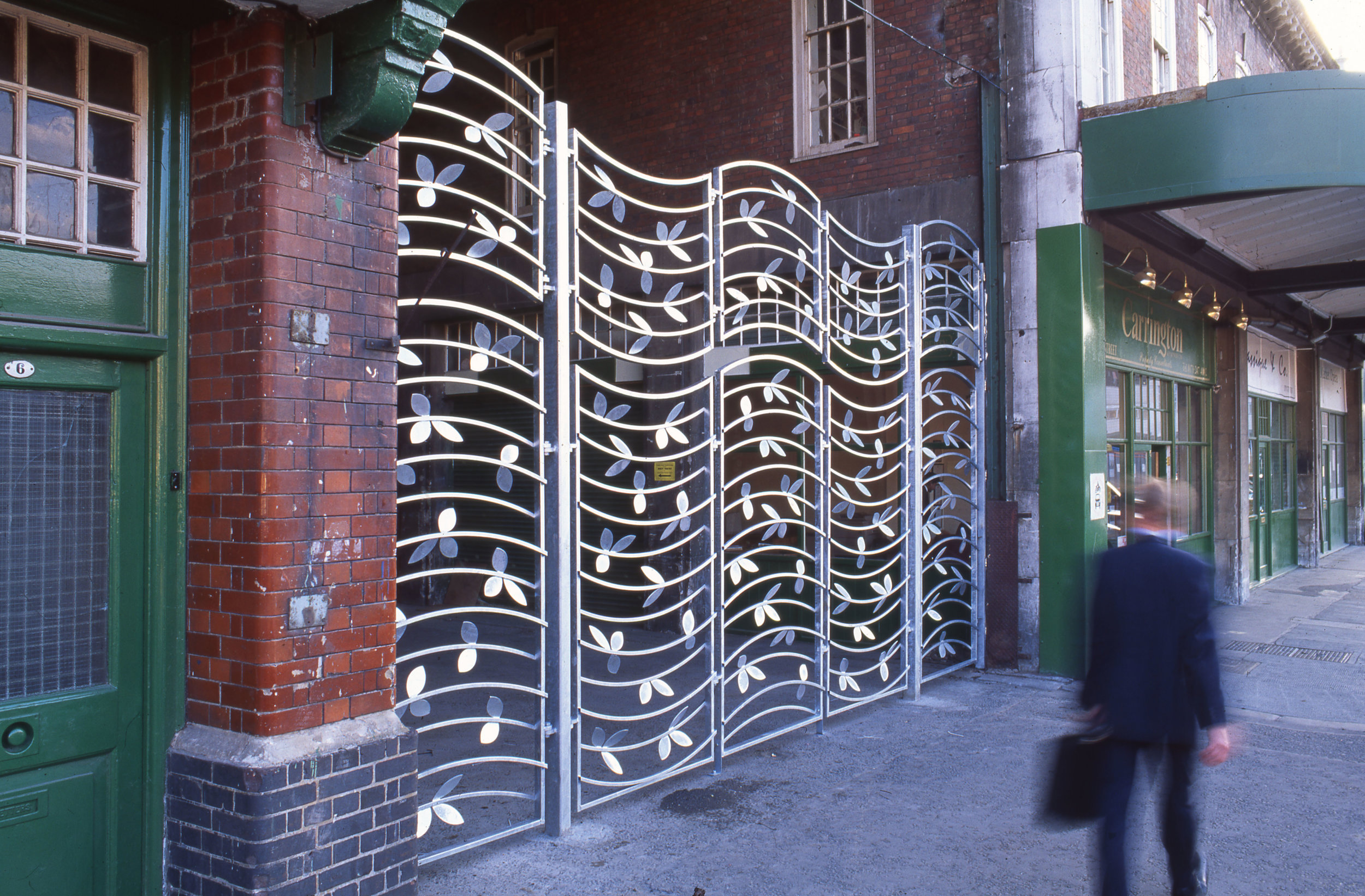 Opera Gates, by Lara Sparey. Galvanised steel gate for Spiatlfields Market.