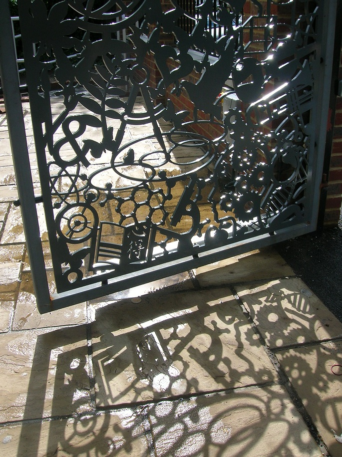 Detail of pedestrian gate with shadow.