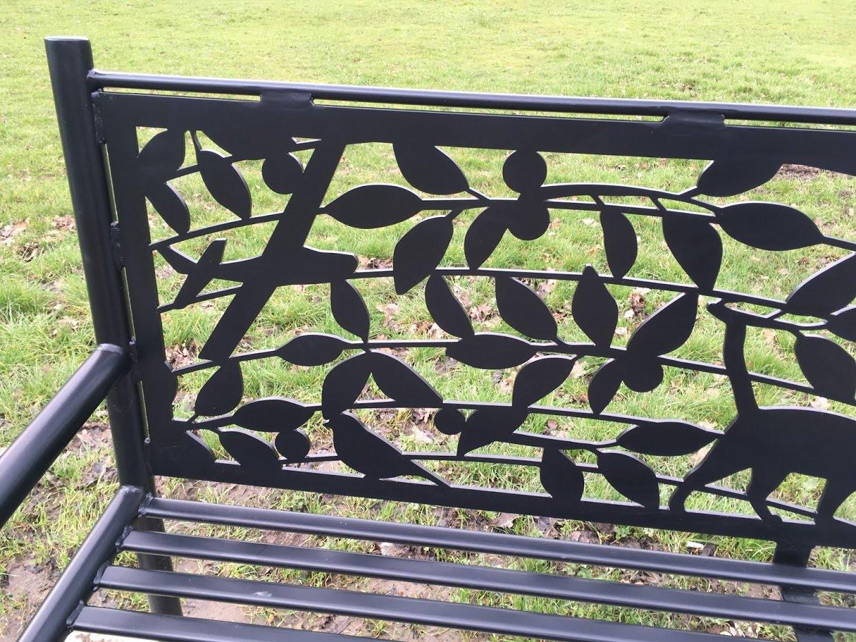 Sir Nicholas Winton Memorial Bench, by Lara Sparey. Bench detail.