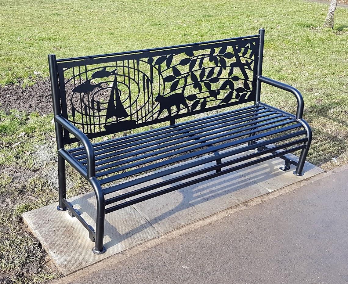Sir Nicholas Winton Memorial Bench, by Lara Sparey. Bench installed in memorial garden.