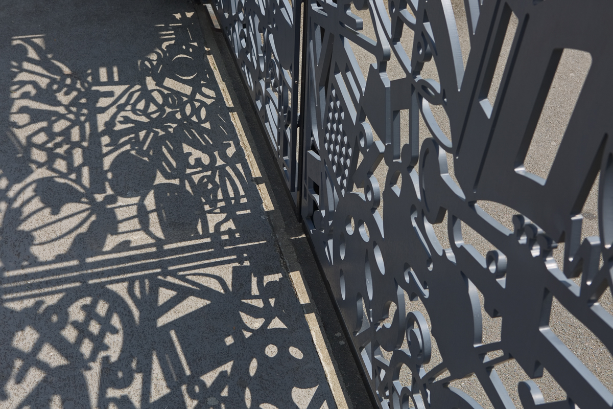 East Barnet Secondary School Gates by Lara Sparey, detail of the waterjet cut gates with shadow