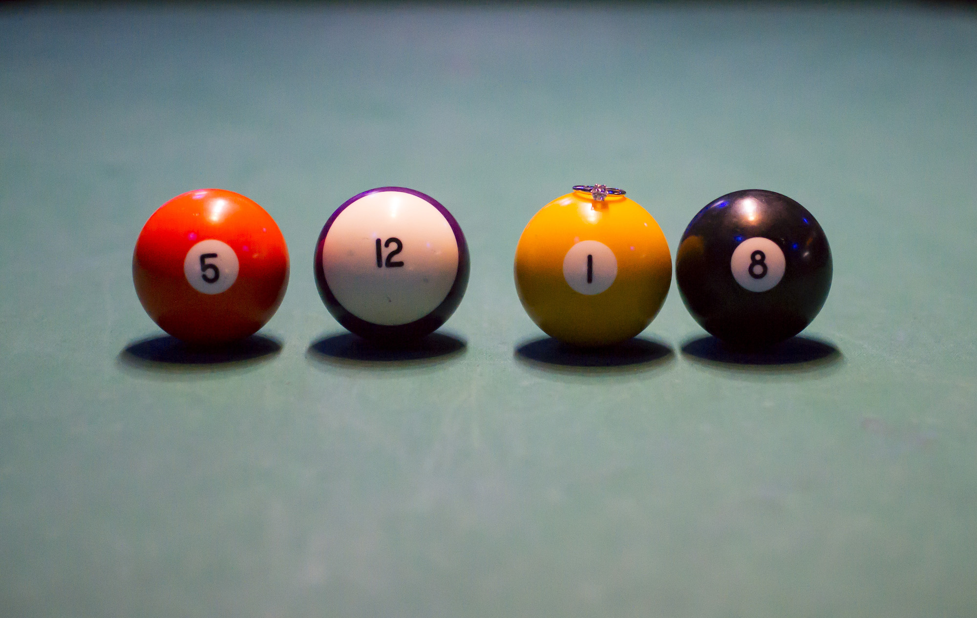 engagement ring on pool balls.jpg