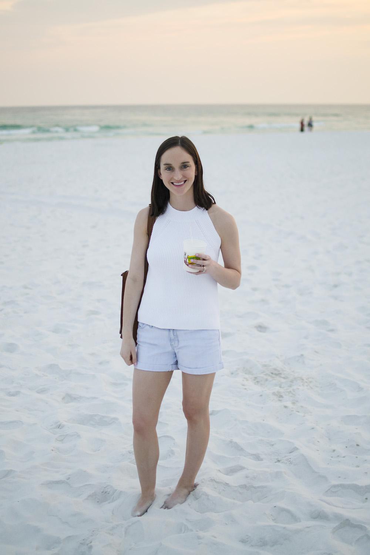 sleeveless white sweater.jpg