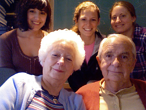 Jim with his caregiver and three students