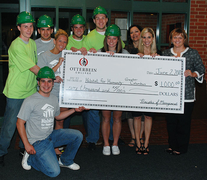 Presenting $1,000 to Habitat for Humanity