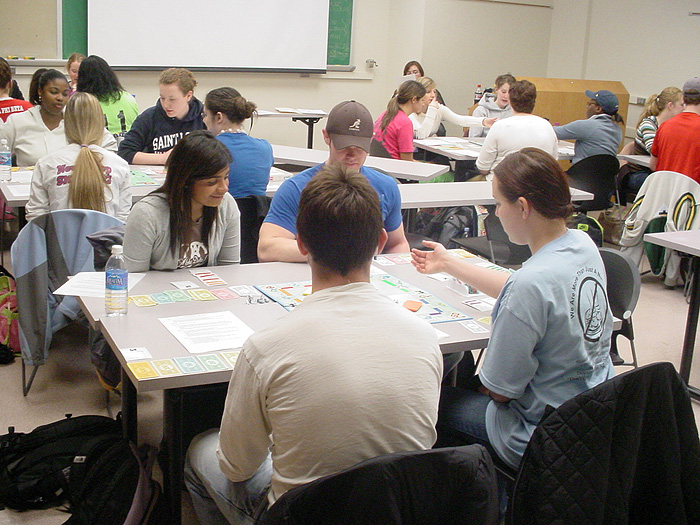 Students playing Intergroup Monopoly