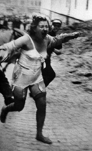Jewish woman chased by men with clubs in  Lviv , Ukraine, 1941