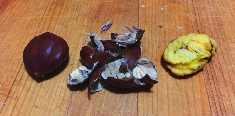 From left to right: A whole chestnut, the shell and husk, final edible chestnut