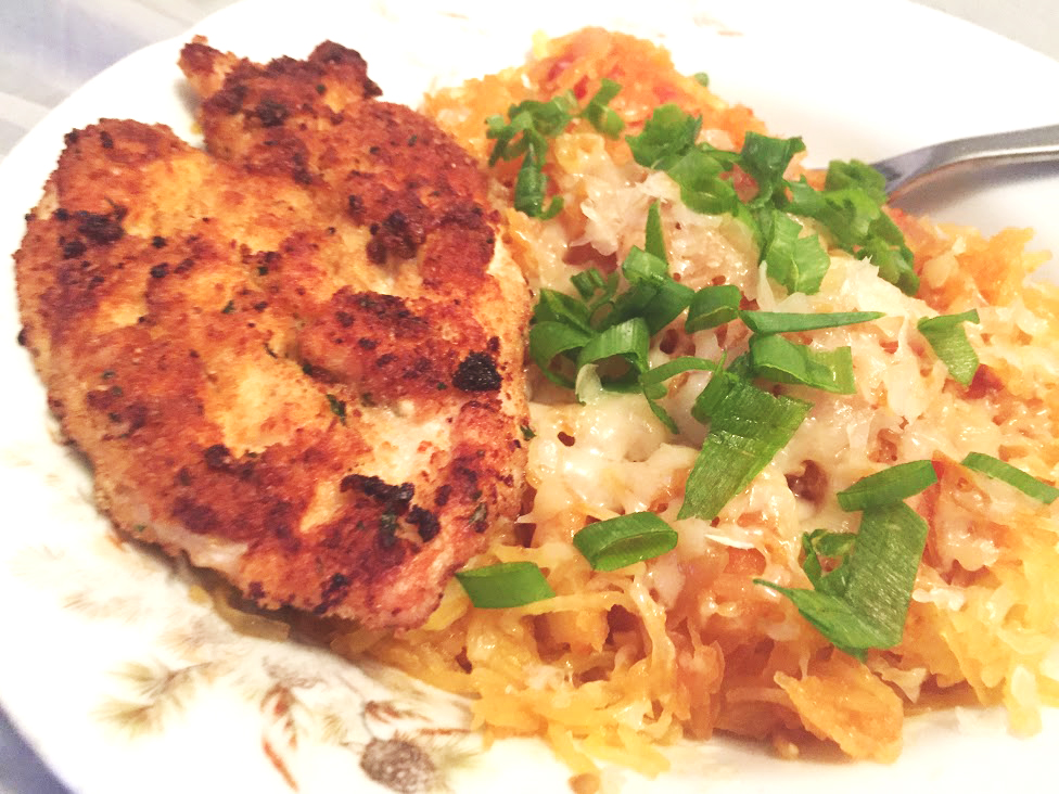 Spaghetti Squash Dinner paired with a pork chop for non-vegetarians.