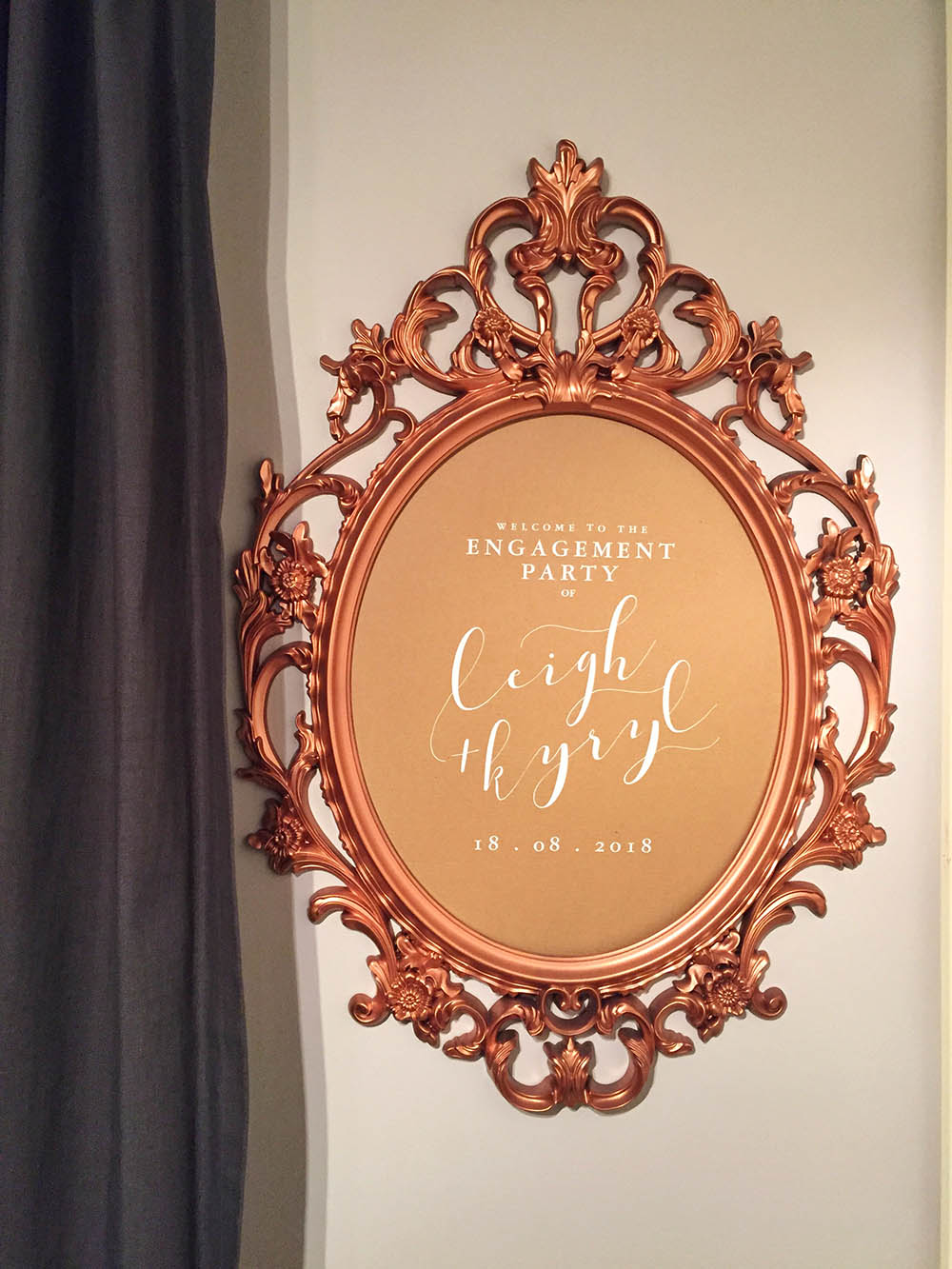 """We wanted something with presence that would really welcome guests with a regal flair but we were also on a budget."" Designed and cut by Rustic Hustle (Frame:   IKEA UNG DRILL    Oval Mirror,  spray painted rose gold.)"