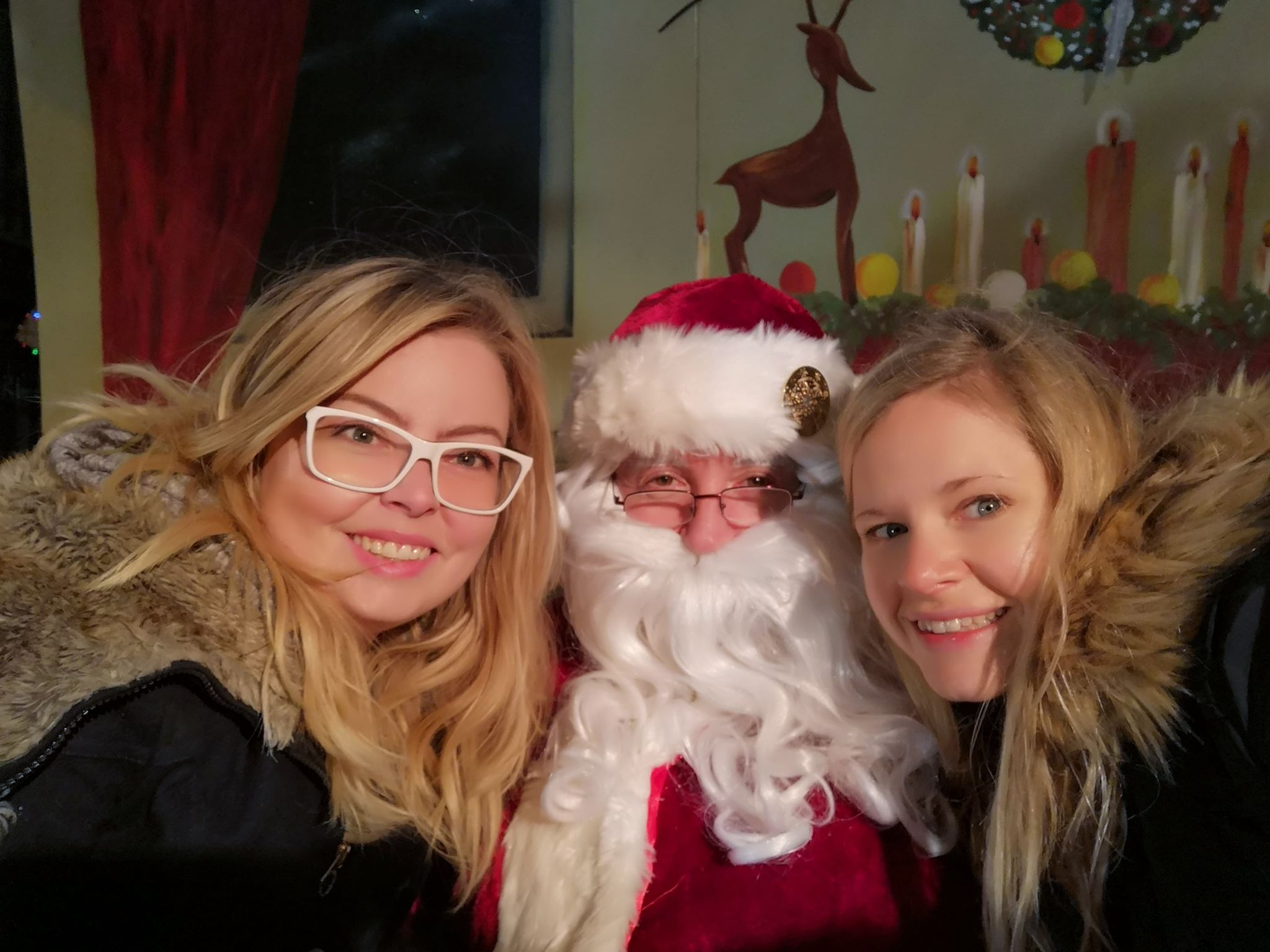 From left: Leigh, Santa and Kristin. This is Leigh's first real picture taken with Santa!