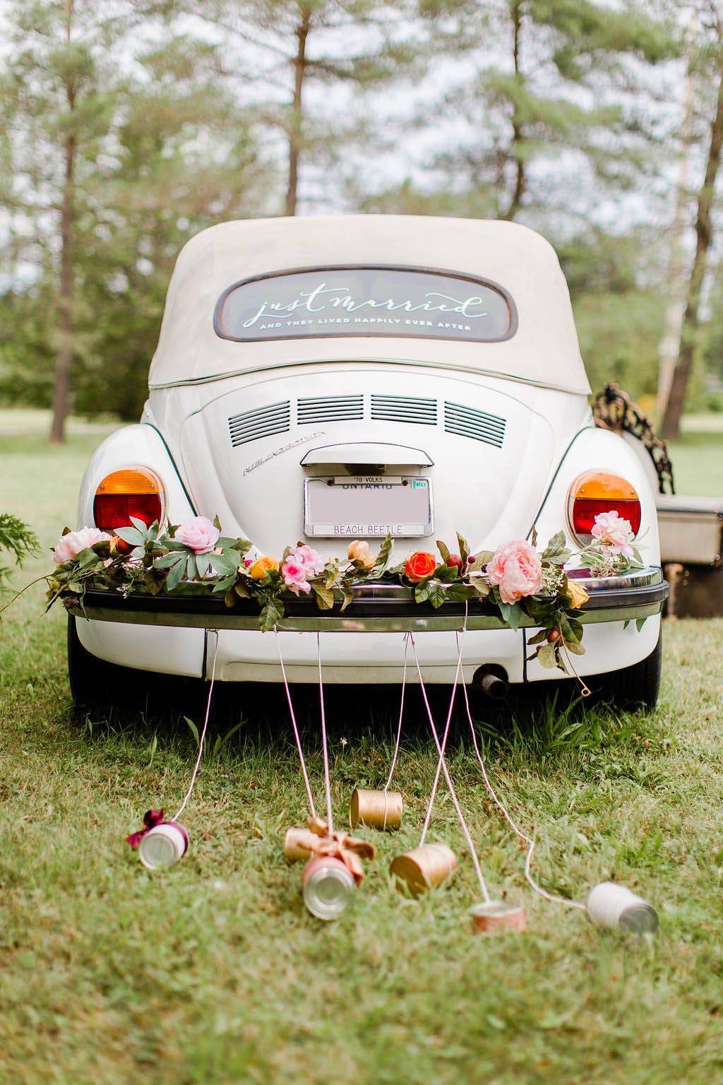How to Style A Wedding Car with Florals and Bowed Up Cans