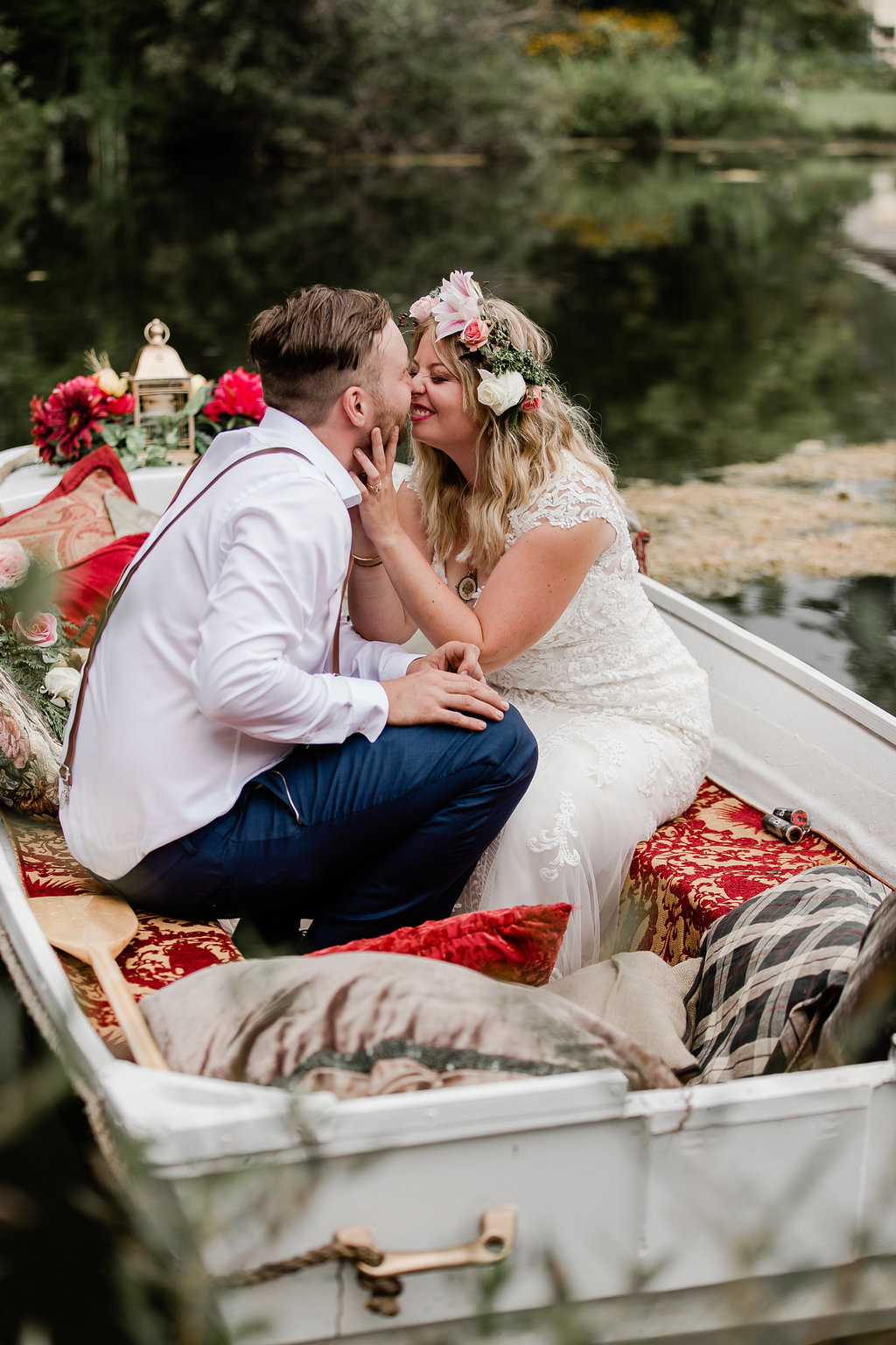 Our refurbished boat was a labour of love. We hauled it out of a field where it had been sitting for years but with a good long power wash and coat of paint, we turned it into a romantic setting for some of our best wedding pictures. Couch cushions thrown in on the day of made it even better!