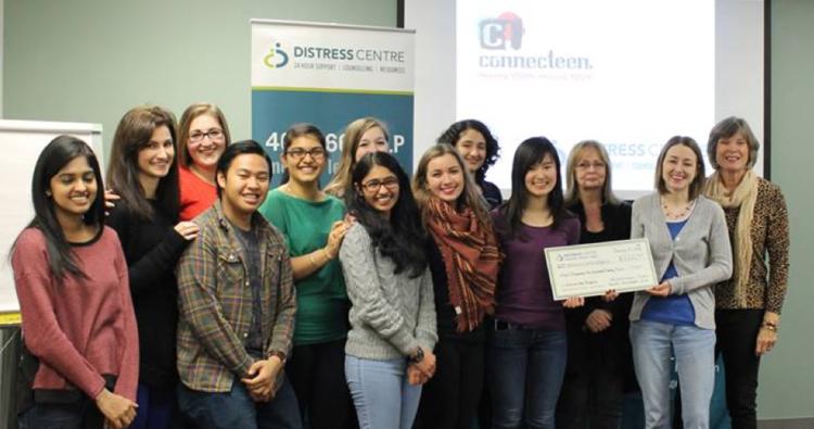 Cheque presentation following the second-annual Outrun the Stigma Calgary fundraiser for Distress Centre.