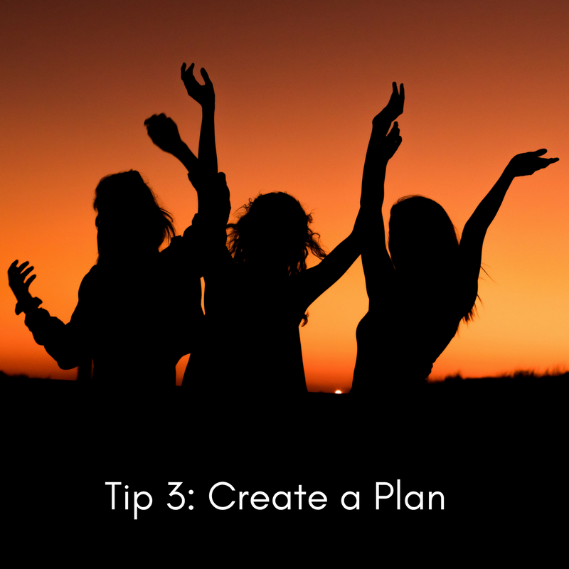 Image description: Silhouette of women dancing against a sunset. White text reads ' Tip 3: Create a Plan'