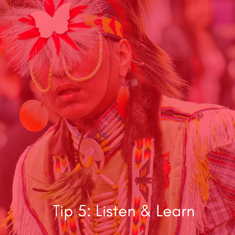 Image description: an Anishinaabe person in traditional attire performs. White text on red overlay reads 'Tip 5: Listen & Learn'