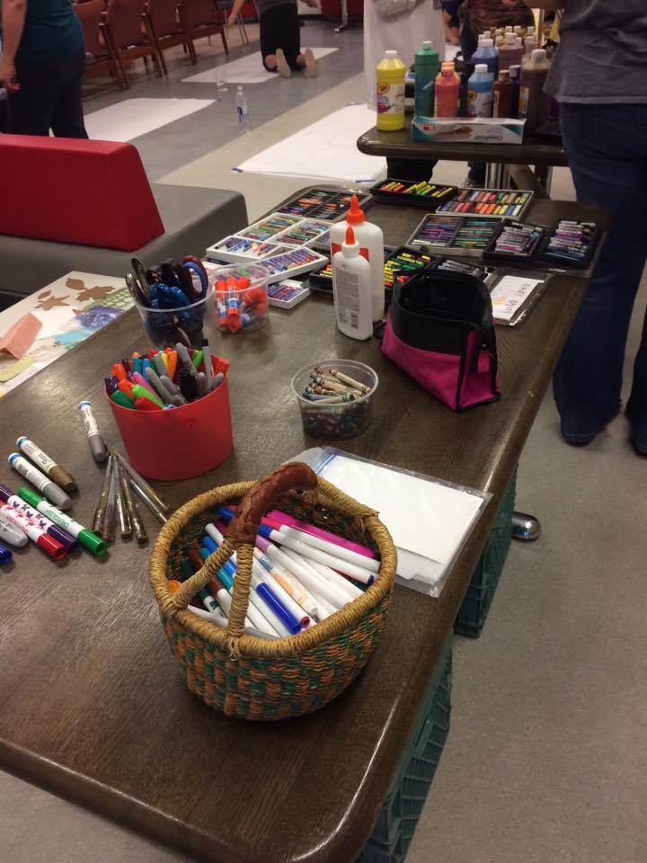 Our participants were well-supplied as they started their experience with body mapping!  Image description: a table of art supplies