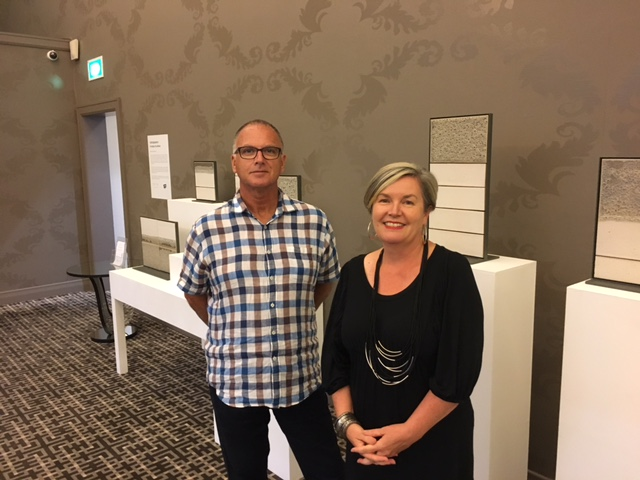 Donald Williams and Lisa Warrener of Global Art Projects at the Sofitel in front of a new ceramic exhibition they curated