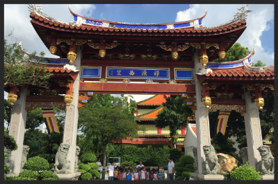 This decorated archway was crafted by Chinese craftsmen. It was explained that the lions at the entrance are auspicious statues as it wards away bad luck.