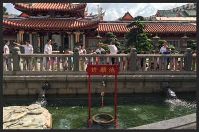 The pond brings about good health and wealth with the ritual of throwing a coin into the well under the bell.