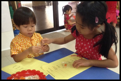 The older children were given the opportunity to help the younger ones in completing their sheets on the 12 zodiac animals and Chinese New Year treats.