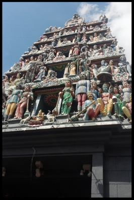 The majestic '  gopuram  ' (grand tower entrance) has six tiers that are covered with sculptures of different Hindu deities and other beings.