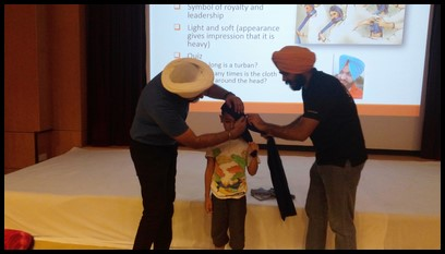 They then asked for a volunteer and Yusuf happily obliged. They then proceeded to show everyone how a turban is wrapped around the head.